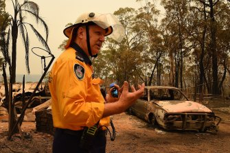 RFS official John Koole inspects a burnt-out home and out-building near Balmoral.