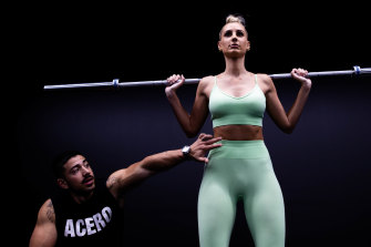 Personal trainer Jono Castano with model Laura Dundovic.