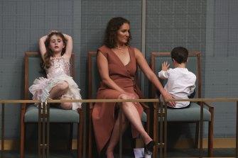 Josh Frydenberg's children, Gemma and Blake, with mum Amie during the Budget speech.