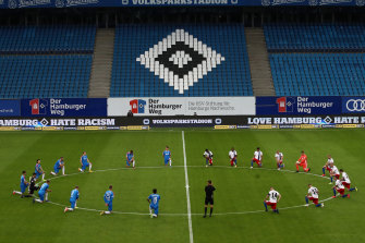 Players from two Bundesliga teams kneel in solidarity with protests over the death of George Floyd.