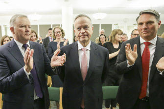 Labor leader Anthony Albanese and deputy Labor leader Richard Marles applaud Bill Shorten at a caucus meeting in Canberra on Thursday.