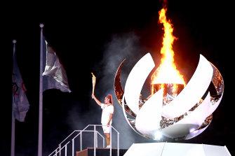 Naomi Osaka lights the Olympic cauldron.