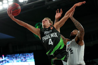 Phoenix's Kyle Adnam, left, drives at the basket during round five against Melbourne United.