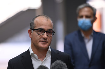 Acting Victorian Premier James Merlino announces an extension of Melbourne's seven-day lockdown as Chief Health Officer Brett Sutton looks on.