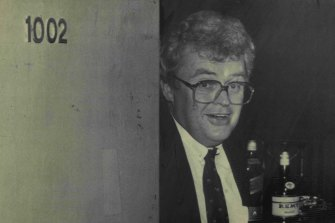 Graham Richardson stands guard at the door of Room 1002 in the Wrest Point casino in the 1980s.