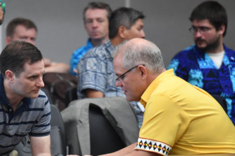 Australia's Minister for International Development Alex Hawke (left) and Prime Minister Scott Morrison confer  during the Pacific Islands Forum in Funafuti, Tuvalu on Friday.
