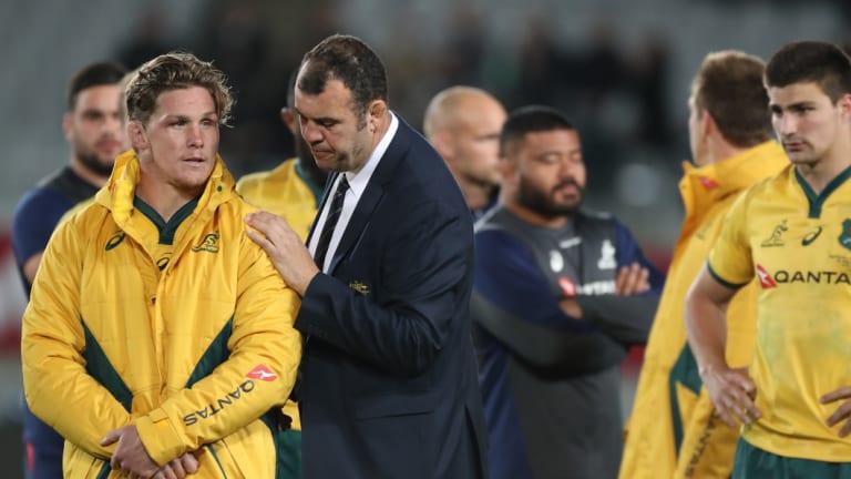 Sinking feeling: Michael Cheika consoles Wallabies skipper Michael Hooper after the loss at Eden park.