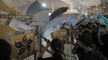 Anti-extradition bill protesters put up umbrellas to defend themselves from riot police at the Central Waterfront in Hong Kong.