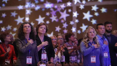 Attendees stand for the American national anthem at the Values Voter Summit, a forum held each year in Washington.