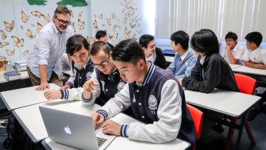 Blakehurst High School's eSports team talk League of Legends tactics in the classroom.