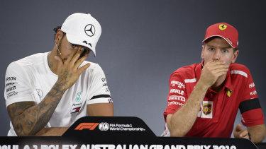 Contrasting fortunes: Lewis Hamilton and Sebastian Vettel.