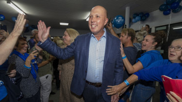 Home Affairs Minister Peter Dutton celebrating his return to the seat of Dickson while in Strathpine on election night.