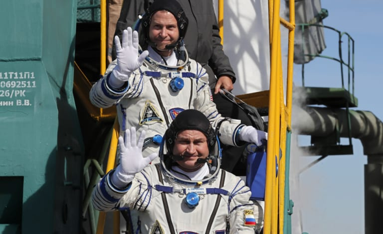 Russian cosmonaut Alexey Ovchinin (front) and US astronaut Nick Hague prior to launch.