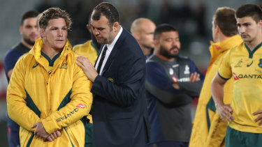 Taking stock: Michael Hooper is comforted by coach Michael Cheika after Bledisloe II in in Auckland.