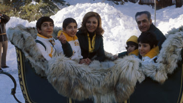 Farah Pahlavi with the Shah and their children in Switzerland, 1975.