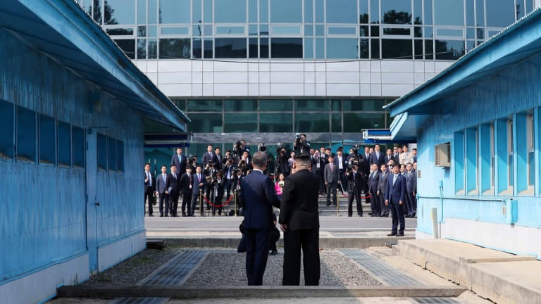 South Korean President Moon Jae-in, left, and North Korean leader Kim Jong-un pose for a photograph as they meet at the truce village of Panmunjom in the Demilitarized Zone last month.