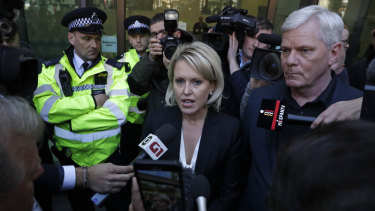 Kristinn Hrafnsson, editor of WikiLeaks (right), and barrister Jennifer Robinson (centre) speak outside court.