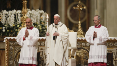 Pope Francis presides over an Easter vigil ceremony in St. Peter's Basilica at the Vatican.