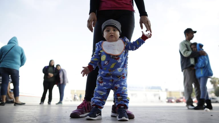 Nine-month-old Jesus Alberto Lopez with his mother, Perla Murillo, as they wait with other families in Tijuana, Mexico to request political asylum in the United States.