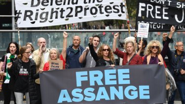 Supporters of Julian Assange and WikiLeaks are seen during a snap rally in Sydney.