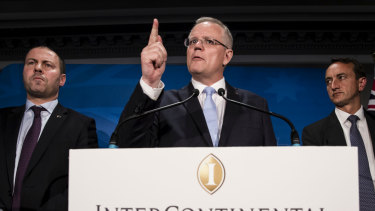 Scott Morrison speaks on Saturday night, flanked by Treasurer Josh Frydenberg and Wentworth candidate Dave Sharma.