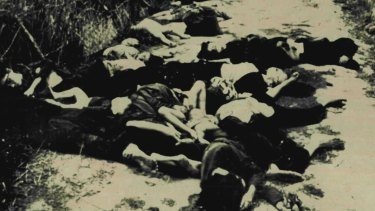 My Lai Massacre Scene: Bodies of woman and children on road leading from village of My Lai in South Vietnam in March 1968.