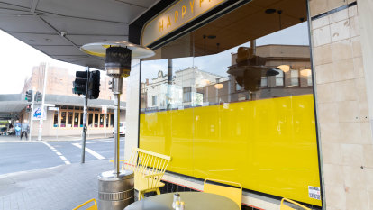 'Storm in a teacup': Cafe ordered to remove yellow signage because it needed council permission