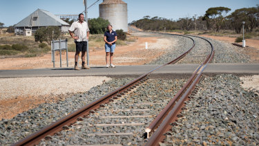 Christine Plant and Brian Barry jnr, crop farmers near Manangatang, say the state government has broken a promise to deliver standardised rail in the region.