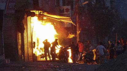 Bloodshed after tensions erupt on Delhi's unfashionable fringe