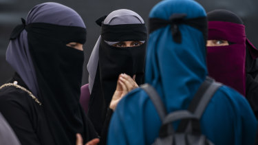 A protest group takes part in a demonstration against the first fine given for wearing the face veil niqab in Copenhagen.