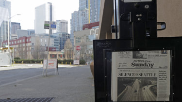 The street next to a Seattle Times newspaper box in front of the building that houses its newsroom is empty as the US economy takes a hit.