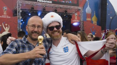 Melting pot: English and Russian fans pose for a photo as they watch the group G soccer match between England and Panama.