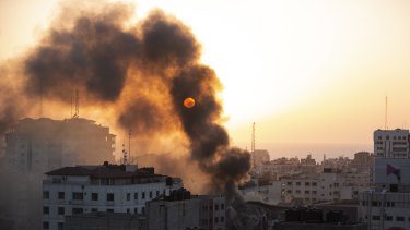 Smoke is seen from a collapsed building after it was hit by Israeli airstrikes on Gaza City.