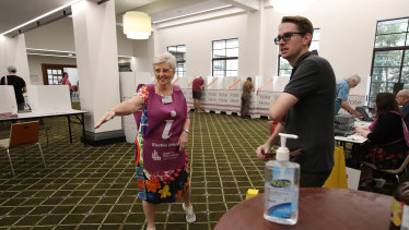 An election official directs voters at Brisbane City hall polling booth.