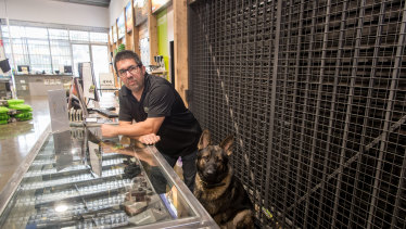 Mr Cauchi, pictured with his dog Bane, has lost almost all his business due to the suspension of sales.