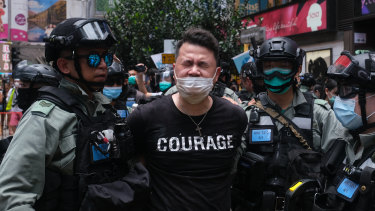 Andrew Wan, a pro-democracy legislator, is arrested by riot police during a protest in Hong Kong on Wednesday.