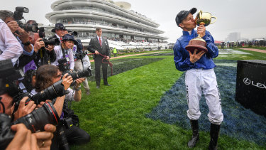 Kerrin McEvoy celebrates victory in the 2018 Melbourne Cup on Cross Counter.