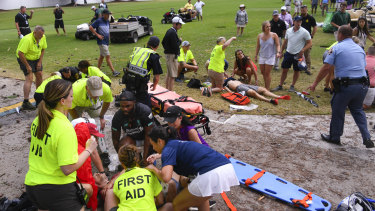 Freak event: Spectators receive treatment after a lightning strike on the East Lake Golf Club course left several injured in Atlanta.