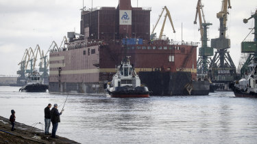 The floating nuclear power plant, the 'Akademik Lomonosov', is towed out of the St Petersburg shipyard on  Saturday.