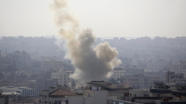 Smoke rises after an Israeli forces strike in Gaza City on Tuesday.