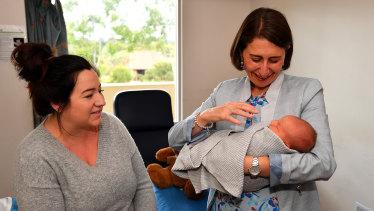 Gladys Berejiklian holds baby Jordan Hiley alongside mother Lauren Mitchell during the Premier's visit to Blacktown Hospital on Thursday.