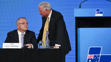 Nick Greiner speaks to Prime Minister Scott Morrison at the Hyatt Hotel in Canberra on Friday.