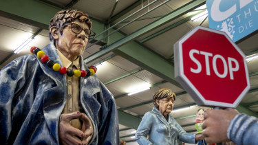 Figures depicting German Chancellor Angela Merkel, right, and CDU leader Annegret Krampp-Karrenbauer cast in papier-machet for the Mainz carnival.