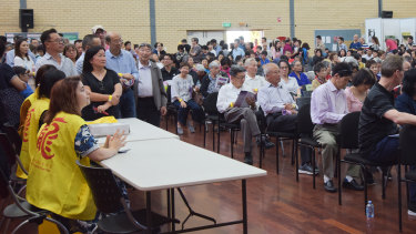 Chung Wah members line up waiting to vote for a new president at Saturday's annual general meeting.