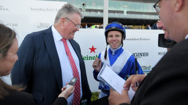 Trainer Anthony Cummings and jockey Tommy Berry after a  win on Libertini.