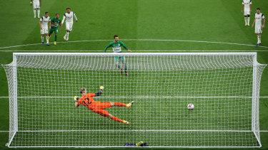 Nikita Rukavytsta puts a penalty past Tottenham Hotspur goalkeeper Joe Hart in the Europa League.