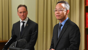 China's consul-general for Victoria Zhou Long (right) and Health Minister Greg Hunt.