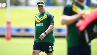 PM's XIII coach Mal Meninga runs the team through their paces in Fiji.