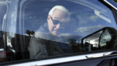 Roger Stone leaves federal court in Washington.