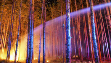 Firefighters battle a wildfire near the village Klausdorf, about 85 kilometres south of Berlin